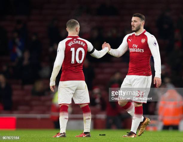 Arsenal's Sead Kolasinac shakes hands with team mate Jack Wilshere at full time during the Premier League match between Arsenal and Crystal Palace at...