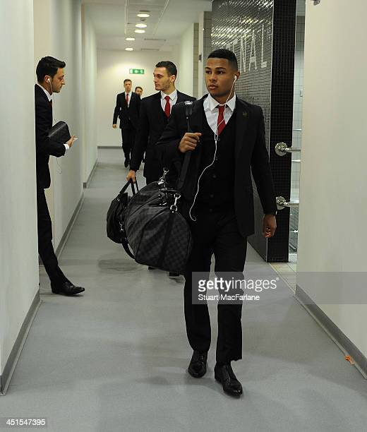 Arsenal's Serge Gnabry arrives in the changing room before the match at Emirates Stadium on November 23 2013 in London England