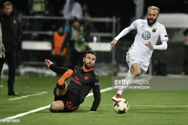 Arsenal's Shkodran Mustafi and Ostersund's Curtis Edwards vie for ball during the UEFA Europa League round of 32 first leg football match of...