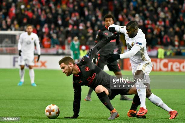 Arsenal's Shkodran Mustafi and Ostersund's Ken Sema vie for the ball during the UEFA Europa League round of 32 first leg football match of Ostersund...