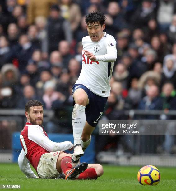 Arsenal's Shkodran Mustafi and Tottenham Hotspur's Son HeungMin battle for the ball during the Premier League match at Wembley Stadium London