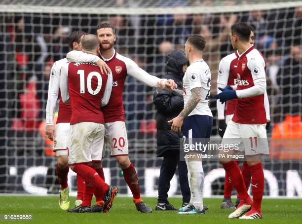 Arsenal's Shkodran Mustafi separates Jack Wilshere and Tottenham Hotspur's Kieran Trippier after the Premier League match at Wembley Stadium London