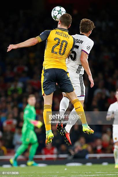 Arsenals Shkodran Mustafi vies with Basel's Alexander Fransson during Champions League Group A match between Arsenal FC and FC Basel at Emirates...