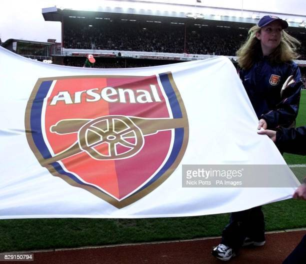 Arsenal's show off the new club crest to fans launched at Highbury prior to their FA Barclaycard Premiership match with visiting Southampton at...
