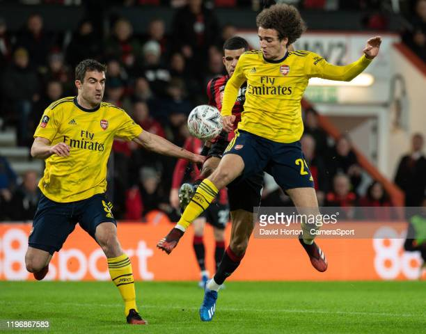 Arsenal's Sokratis and Matteo Guendouzi under pressure from Bournemouth's Dominic Solanke during the FA Cup Fourth Round match between Bournemouth...