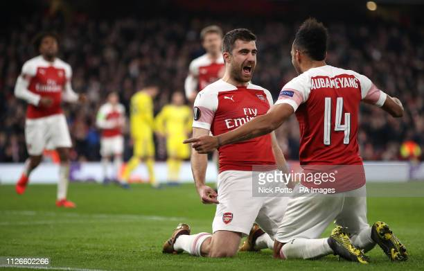 Arsenal's Sokratis Papastathopoulos celebrates scoring his side's third goal of the game with teammate PierreEmerick Aubameyang during the UEFA...