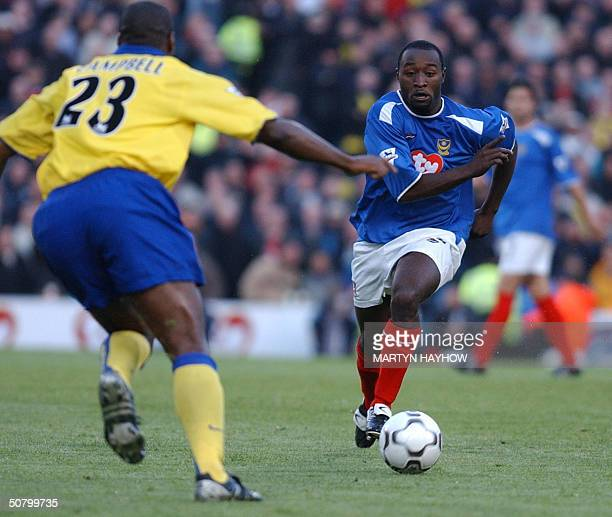 Arsenal's Sol Campbell moves in to tackle Portsmouth's Lomana Tresor Lua Lua 04 May 2004 during their league match at Portsmouth AFP PHOTO/ Martyn...