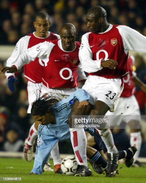 Arsenal's Sol Campbell Patrick Viera and Gilberto hassle for the ball with Steven Pienaar of Ajax during a Champions league match at Highbury Stadium...