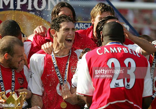 Arsenal's Sol Campbell sprays Martin Keown with Champaigne after Arsenal won the Premiership title and defeating Leicsester City 15 May 2004 at...