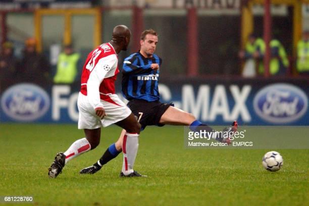 Arsenal's Sol Campbell takes on Inter Milan's Andy van der Meyde