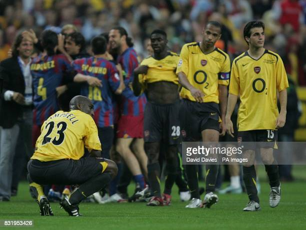 Arsenal's Sol Campbell Thierry Henry and Francesc Fabregas stand dejected after Barcelona's victory