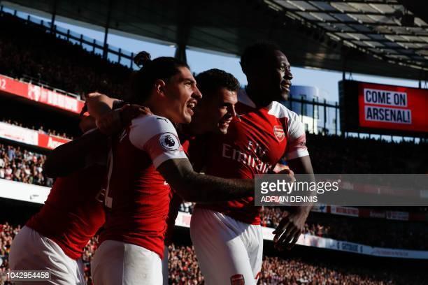 Arsenal's Spanish defender Hector Bellerin Arsenal's Swiss midfielder Granit Xhaka and Arsenal's English striker Danny Welbeck celebrate their first...