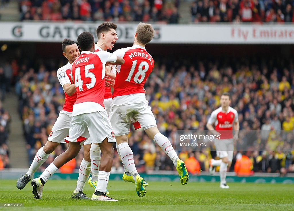 Arsenal's Spanish defender Hector Bellerin (C) celebrates with teammates after scoring during the English Premier League football match between Arsenal and Watford at the Emirates Stadium in London on April 2, 2016. / AFP / Ian Kington / RESTRICTED TO EDITORIAL USE. No use with unauthorized audio, video, data, fixture lists, club/league logos or 'live' services. Online in-match use limited to 75 images, no video emulation. No use in betting, games or single club/league/player publications. /