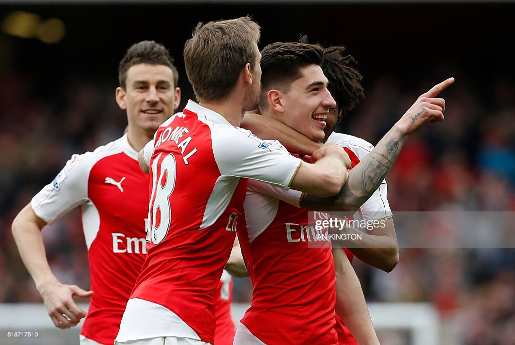 Arsenal's Spanish defender Hector Bellerin (R) celebrates with teammates after scoring during the English Premier League football match between Arsenal and Watford at the Emirates Stadium in London on April 2, 2016. / AFP / Ian Kington / RESTRICTED TO EDITORIAL USE. No use with unauthorized audio, video, data, fixture lists, club/league logos or 'live' services. Online in-match use limited to 75 images, no video emulation. No use in betting, games or single club/league/player publications. /