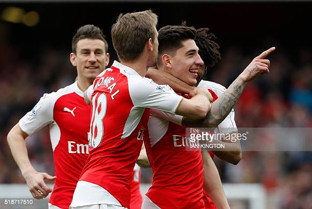 Arsenal's Spanish defender Hector Bellerin celebrates with teammates after scoring during the English Premier League football match between Arsenal...