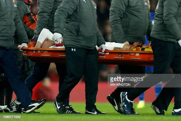 Arsenal's Spanish defender Hector Bellerin is taken off on a stretcher after picking up an injury during the English Premier League football match...