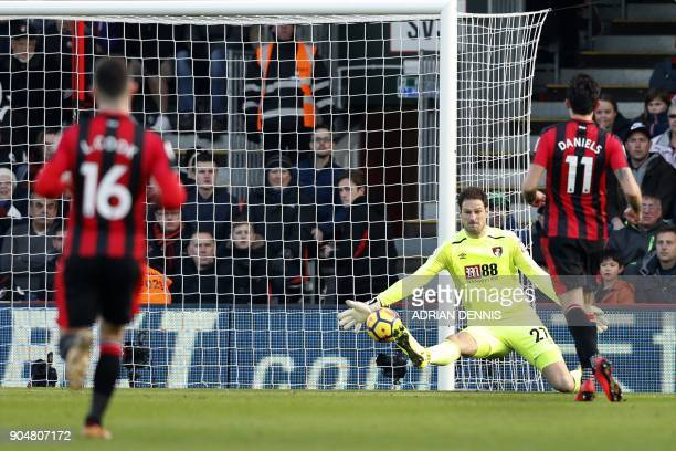 Arsenal's Spanish defender Hector Bellerin scores the team's first goal past Bournemouth's BosnianHerzegovinian goalkeeper Asmir Begovic during the...