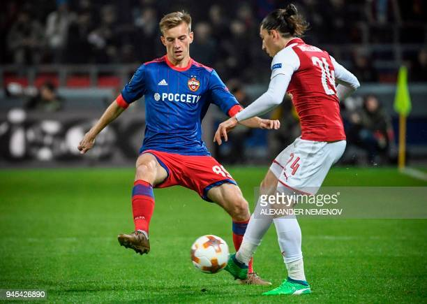 Arsenal's Spanish defender Hector Bellerin vies for he ball against CSKA Moscow's Russian midfielder Konstantin Kuchayev during the UEFA Europa...