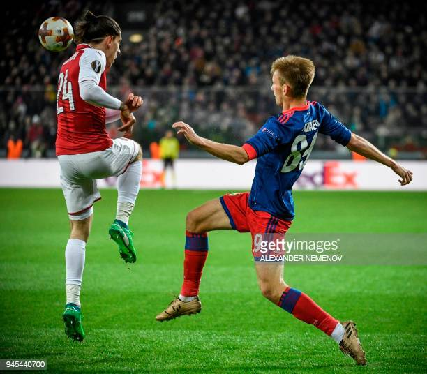 Arsenal's Spanish defender Hector Bellerin vies for the ball with CSKA Moscow's Russian midfielder Konstantin Kuchayev during the UEFA Europa League...