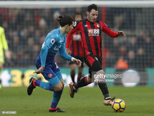 Arsenal's Spanish defender Hector Bellerin vies with Bournemouth's English defender Adam Smith during the English Premier League football match...