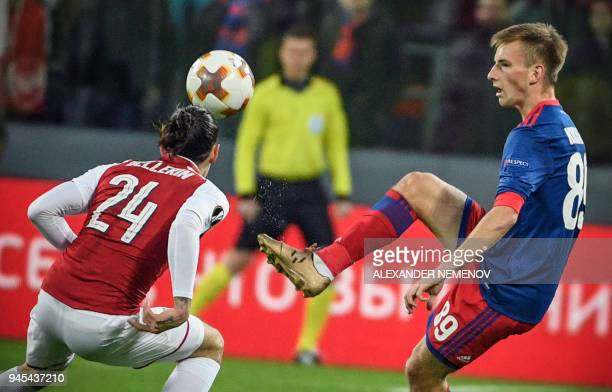 Arsenal's Spanish defender Hector Bellerin vies with CSKA Moscow's Russian midfielder Konstantin Kuchayev during the UEFA Europa League second leg...