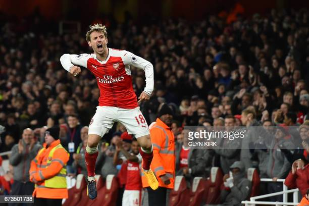Arsenal's Spanish defender Nacho Monreal celebrates after his shot is deflected into the Leicester net by Leicester City's German defender Robert...