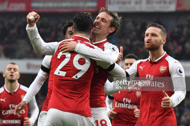 Arsenal's Spanish defender Nacho Monreal celebrates after scoring with Arsenal's Swiss midfielder Granit Xhaka during the English Premier League...