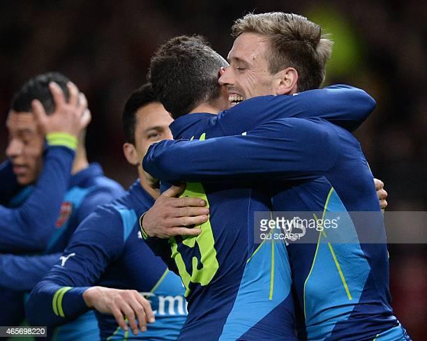 Arsenal's Spanish defender Nacho Monreal celebrates scoring the opening goal with Arsenal's Spanish midfielder Santi Cazorla during the FA Cup...