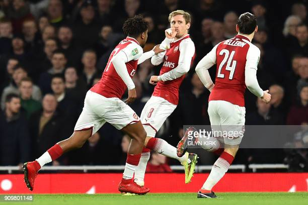 Arsenal's Spanish defender Nacho Monreal celebrates scoring the team's first goal during the League Cup semifinal football match between Arsenal and...