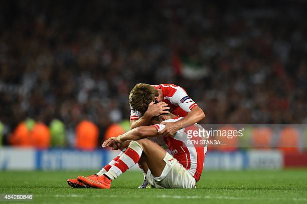 Arsenal's Spanish defender Nacho Monreal celebrates with Arsenal's Chilean striker Alexis Sanchez at the final whistle during the UEFA Champions...