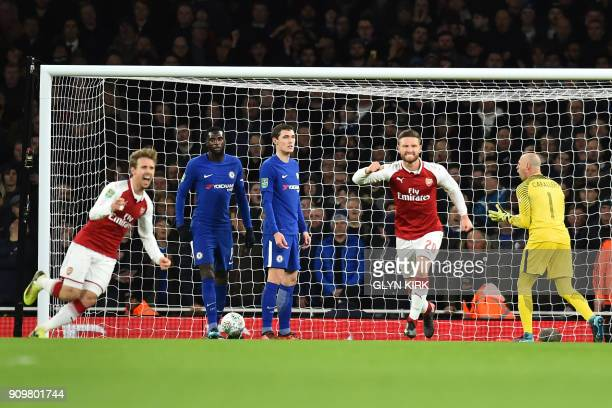 Arsenal's Spanish defender Nacho Monreal celebtrates scoring the team's first goal with Arsenal's German defender Shkodran Mustafi past Chelsea's...