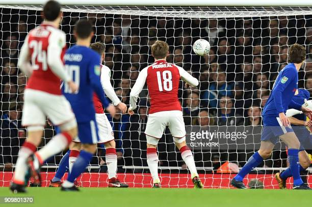 Arsenal's Spanish defender Nacho Monreal scores the team's first goal during the League Cup semifinal football match between Arsenal and Chelsea at...