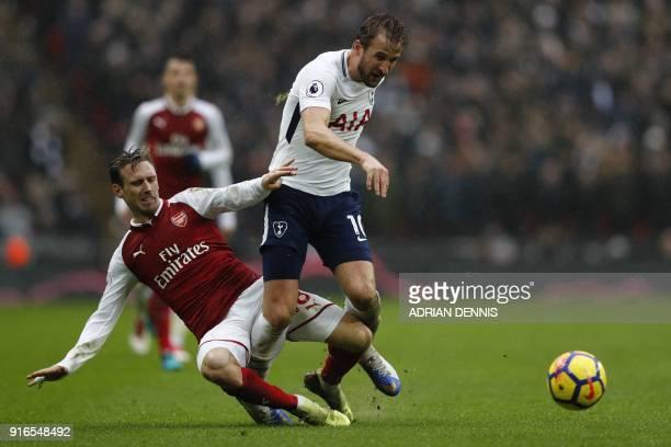 Arsenal's Spanish defender Nacho Monreal tackles Tottenham Hotspur's English striker Harry Kane during the English Premier League football match...