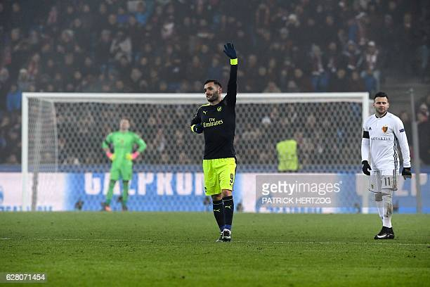Arsenal's Spanish forward Lucas Perez celebrates his third goal next to Basel's Swiss midfielder Renato Steffen and Basel's Czech goalkeeper Tomas...
