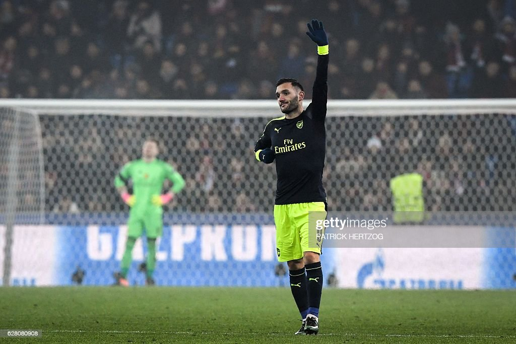 Arsenal's Spanish forward Lucas Perez (R) celebrates his third goal next to Basel's Czech goalkeeper Tomas Vaclik (L) during the UEFA Champions league Group A football match between FC Basel 1893 and Arsenal FC on December 6, 2016 at the St Jakob Park stadium in Basel. / AFP / Patrick HERTZOG