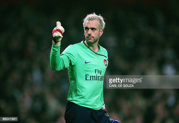Arsenal's Spanish goalkeeper Manuel Almunia gives a thumb to supporters during their Champions League match against AS Roma at home to Arsenal at the...