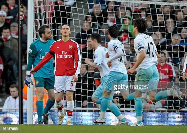 Arsenal's Spanish goalkeeper Manuel Almunia looks on as Burnley's English striker David Nugent celebrates scoring during the English Premier League...