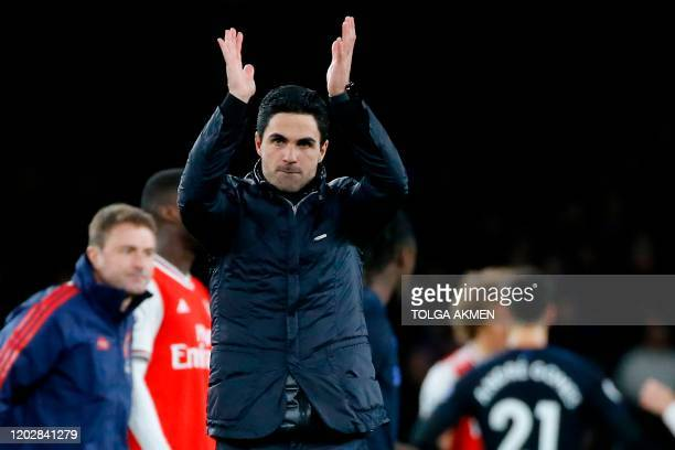 Arsenal's Spanish head coach Mikel Arteta applauds at the end of the English Premier League football match between Arsenal and Everton at the...