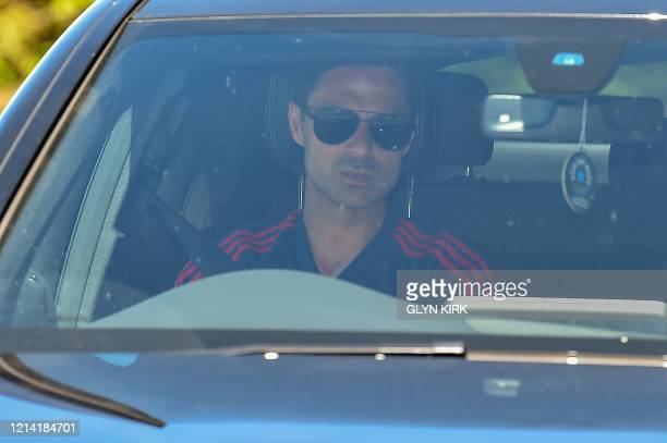 Arsenal's Spanish head coach Mikel Arteta arrives at at Arsenal's Colney training centre north of London on May 20 2020 as training continues for...