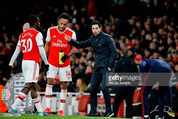 Arsenal's Spanish head coach Mikel Arteta gives instructions to Arsenal's English striker Eddie Nketiah and Arsenal's Gabonese striker PierreEmerick...