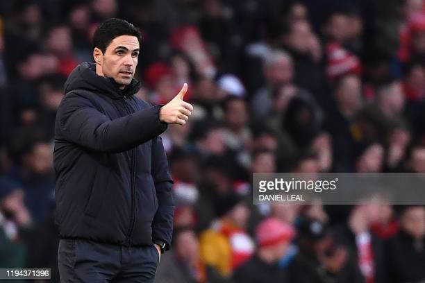 Arsenal's Spanish head coach Mikel Arteta shouts instructions to his players from the touchline during the English Premier League football match...