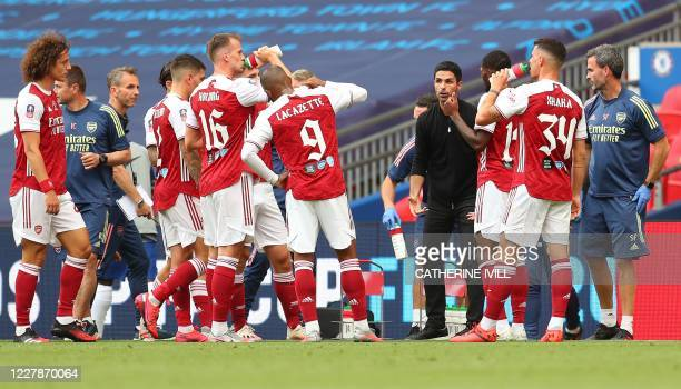 Arsenal's Spanish head coach Mikel Arteta talks to his players during a drinks break in the first half of the English FA Cup final football match...