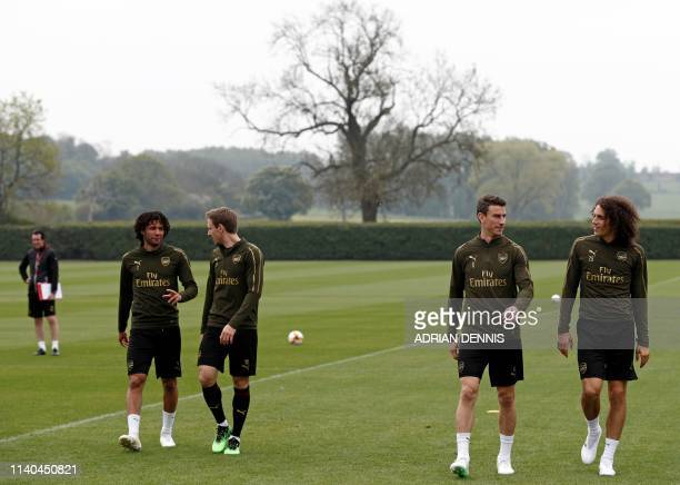 Arsenal's Spanish head coach Unai Emery , Arsenal's Egyptian midfielder Mohamed Elneny , Arsenal's Spanish defender Nacho Monreal, Arsenal's French...