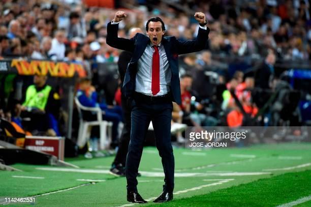 Arsenal's Spanish head coach Unai Emery celebrates his team's third goal during the UEFA Europa League semifinal second leg football match between...