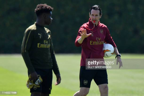 Arsenal's Spanish head coach Unai Emery takes a training session at Arsenal's London Colney training centre in St. Albans on May 21, 2019 ahead of...
