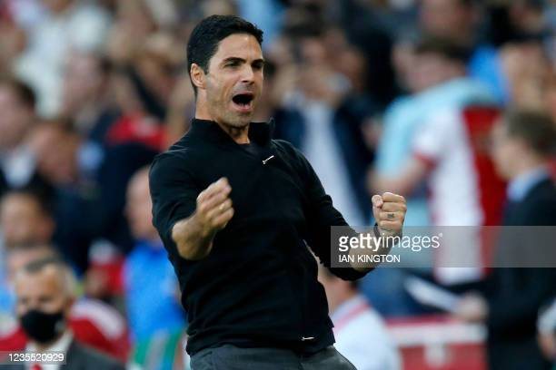 Arsenal's Spanish manager Mikel Arteta celebrates on the final whistle in the English Premier League football match between Arsenal and Tottenham...
