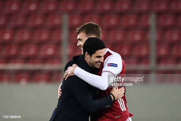 Arsenal's Spanish manager Mikel Arteta congratulates Arsenal's English defender Calum Chambers at the end of the UEFA Europa League 32 Second Leg...