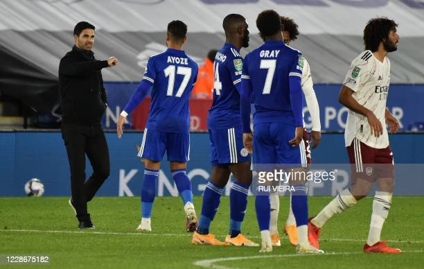 Arsenal's Spanish manager Mikel Arteta elbow bumps Leicester City's Spanish striker Ayoze Perez after the English League Cup third round football...