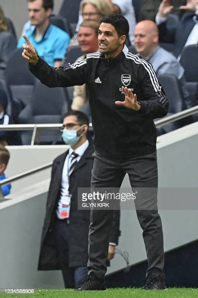 Arsenal's Spanish manager Mikel Arteta gestures on the touchline during the pre-season friendly football match between Tottenham Hotspur and Arsenal...