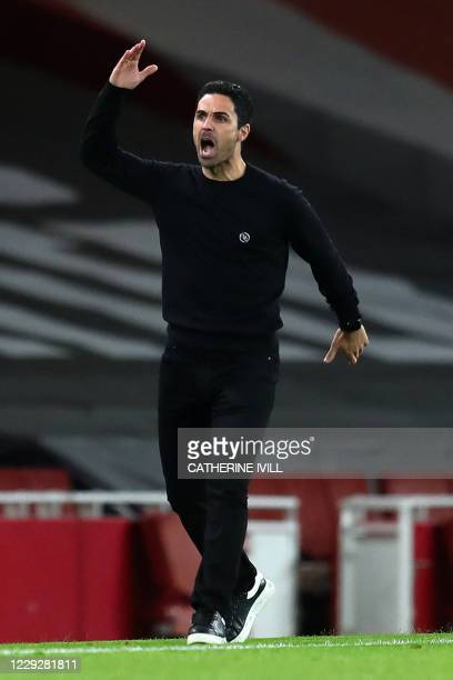 Arsenal's Spanish manager Mikel Arteta shouts instructions to his players from the touchline during the English Premier League football match between...